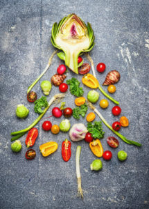 49120723 - christmas tree made of fresh vegetables on rustic gray background, top view.